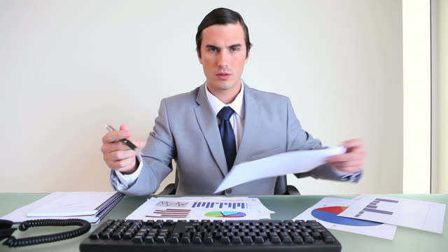 Serious businessman checking documents