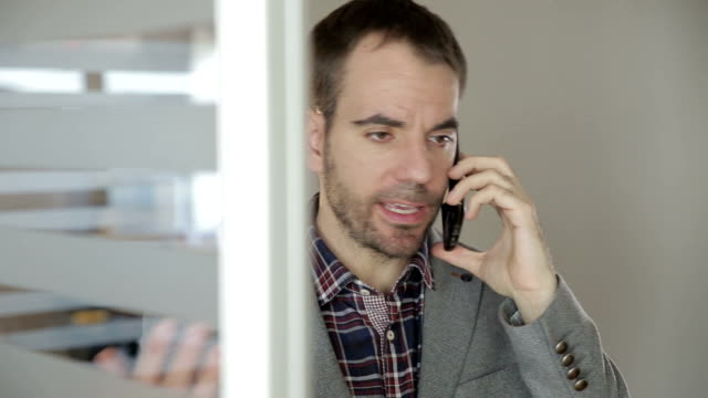 serious businessman discussing on a phone - digital enhancement stock videos & royalty-free footage