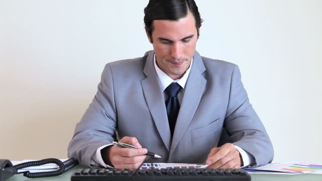 Serious businessman working on charts