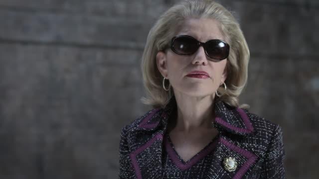 Serious businesswoman wearing sunglasses