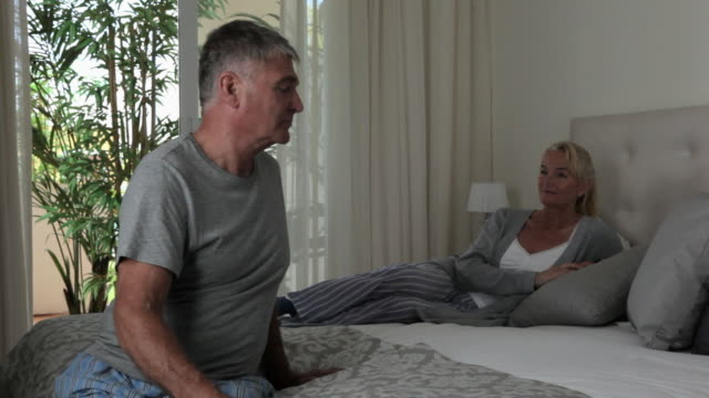 Serious couple in bedroom
