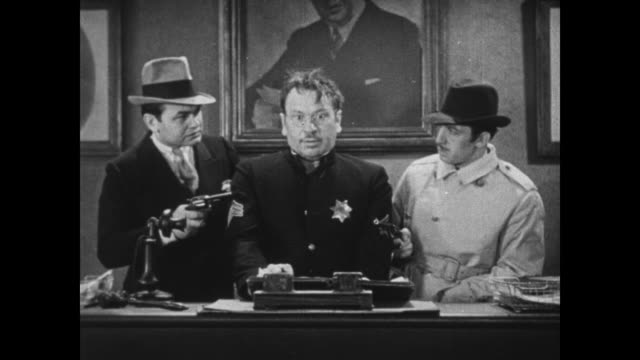 1931 serious criminals edward g robinson and george e stone holdup calm police sergeant, wallace beery - 1931 stock videos & royalty-free footage