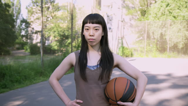 serious female basketball player on court - hand on hip stock videos & royalty-free footage