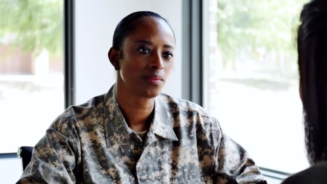 serious female soldier talks with mental health professional - military uniform stock videos & royalty-free footage