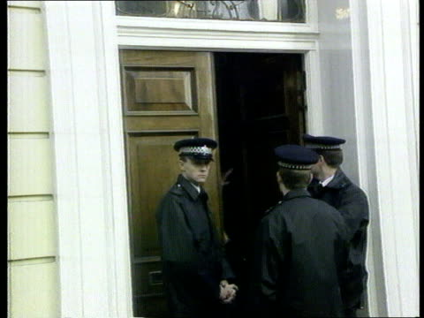 Nadir / Mates issue EXT ENGLAND London Hill Street MS Police on duty in doorway of Polly Peck headquarters building MS More ditto MS Window as...