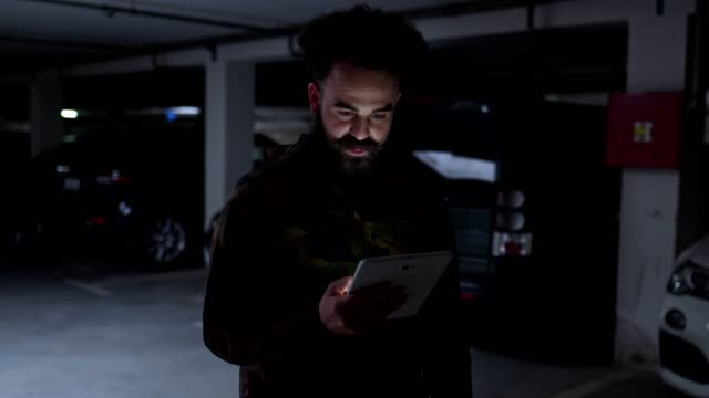 serious hipster influencer holding a digital tablet - camouflage clothing stock videos & royalty-free footage