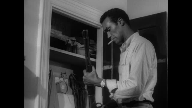 1968 A serious man finds a shotgun and shells in the closet