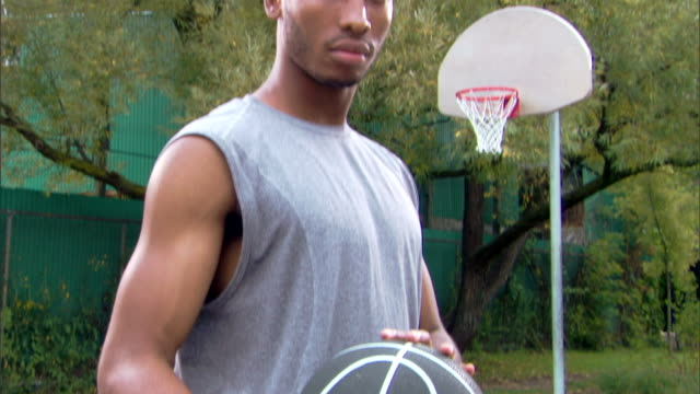 serious man with basketball - see other clips from this shoot 1281 stock videos and b-roll footage