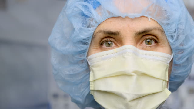 serious, overworked, female health care worker - headshot stock videos & royalty-free footage