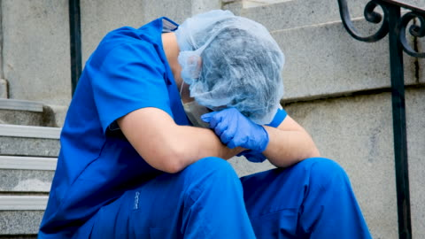 serious, overworked, male health care worker - overworked stock videos & royalty-free footage