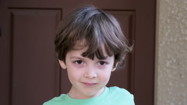 serious pensive little boy looking at the camera - introspection stock videos & royalty-free footage