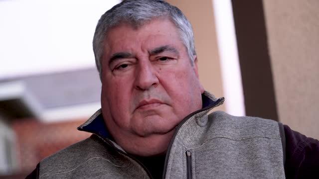 serious pensive overweight hispanic senior man - senior men stock videos & royalty-free footage