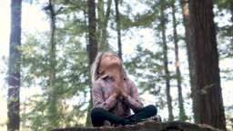 Serious thinking Little girl praying in the woods