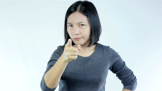 serious woman pointing at camera on white background - displeased stock videos and b-roll footage