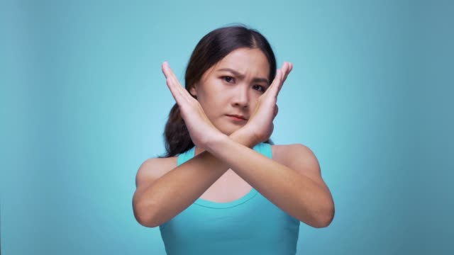 serious woman waving finger no hand sign look at camera on isolated blue background 4k - refusing stock videos & royalty-free footage