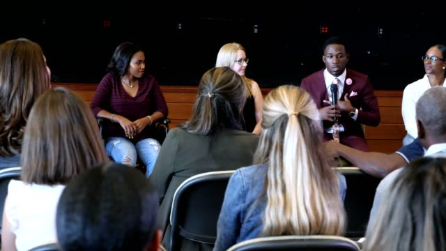 serious young man shares about a difficult situation during a panel discussion - testimony stock videos & royalty-free footage