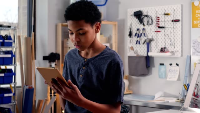 serious young teenage boy uses digital tablet - touchpad stock videos & royalty-free footage
