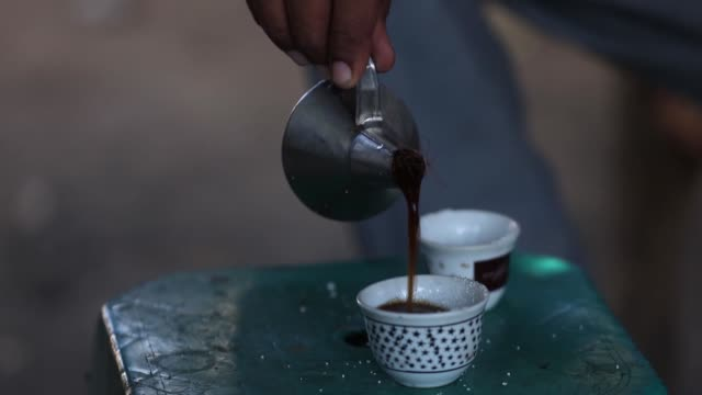 served with ginger coffee is an indispensable part of daily life and culture for sudanese people especially in the country's east the coffee is named... - coffee drink stock videos & royalty-free footage