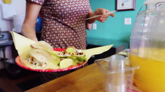 server handing over food in taqueria - mexican restaurant stock videos & royalty-free footage
