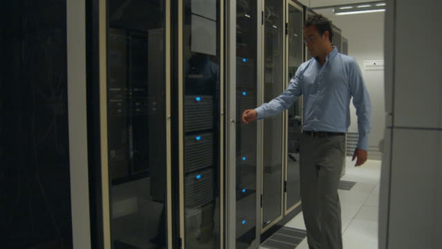 WS DS, Server room, man walking in and working on server, Sydney, Australia