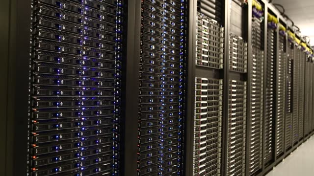 servers stand in a computer room at the yahoo inc lockport data center in lockport new york us shots pan across a row of servers in a server room at... - network server stock videos & royalty-free footage