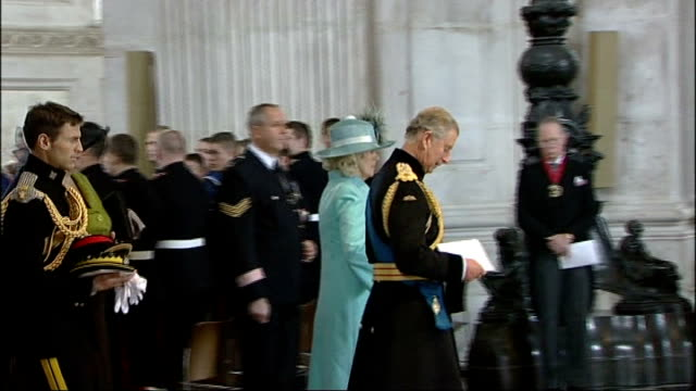 Service in honour of role of armed forces in Northern Ireland INT Flag bearers along inside cathedral Charles and Camilla along inside cathedral at...
