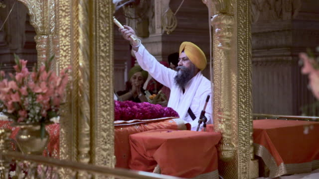 A service inside in a sikh temple, India