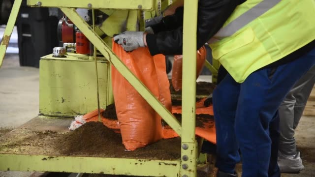 service member with grand forks air force base volunteered to fill several thousand sandbags for the city of grand forks in preparation for an... - sandbag stock videos & royalty-free footage