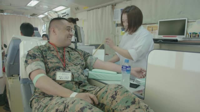 service members and local japanese locals donate blood at marine corps air station iwakuni japan march 12 2019 - disposal container stock videos and b-roll footage