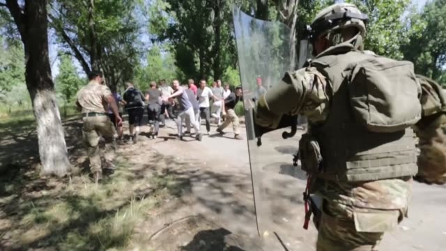 service members from kazakhstan united kingdom united states of america tajikistan and kyrgyzstan train together with riot shields in simulated crowd... - military exercise stock videos and b-roll footage