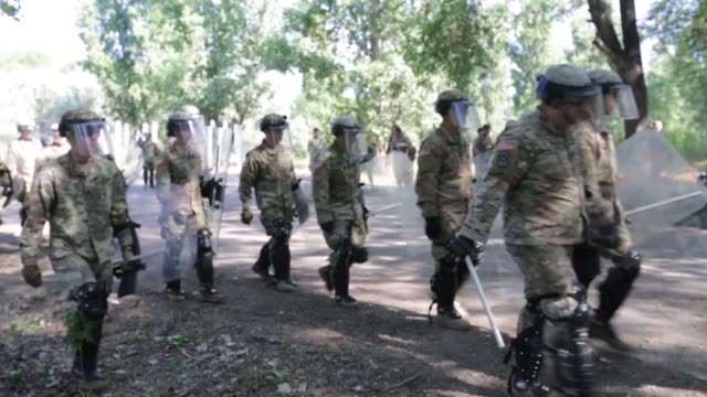 service members from kazakhstan, united kingdom, united states of america, tajikistan and kyrgyzstan train together with riot shields in simulated... - kazakhstan stock videos & royalty-free footage