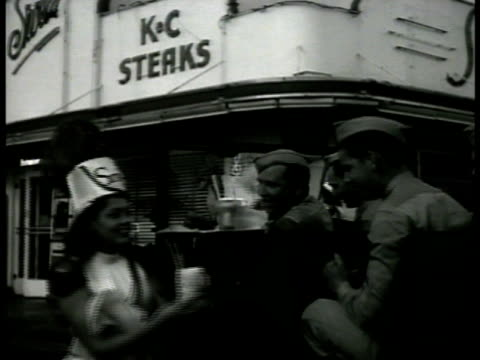 s service men in uniform in open car being served at curb service by waitress 'kc steaks' bg vs men receiving drinks waitress passing out drinks - kansas city kansas stock videos & royalty-free footage
