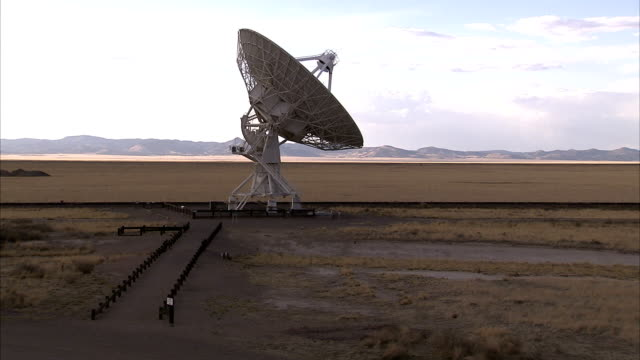 a service road leads to a radio telescope. available in hd. - astronomical telescope stock videos & royalty-free footage