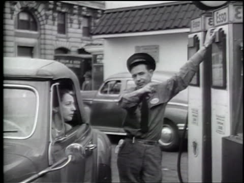 "b/w 1944 pan service station attendant near woman in car + points to ""no gas"" sign by pumps / news. - gas station attendant stock videos and b-roll footage"