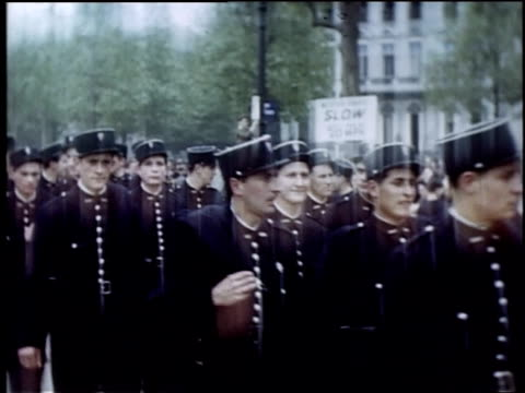 servicemen walking down street prior to a parade / paris france - esercito militare francese video stock e b–roll