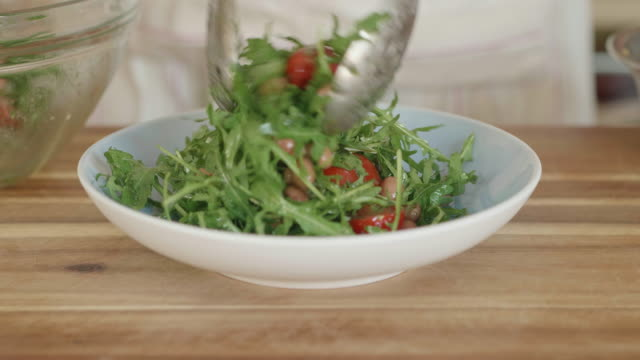 servicing summer rocket leaves tomato salad - salad bowl stock videos & royalty-free footage