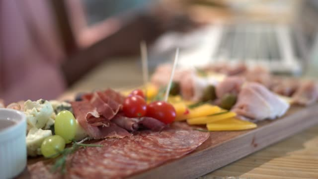 serving a cattail of a board full of cold cuts - wood plate stock videos & royalty-free footage