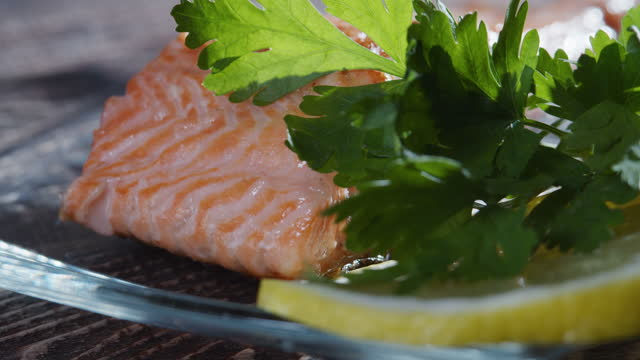 serving a portion of grilled salmon. extreme close-up - grilled salmon stock videos & royalty-free footage