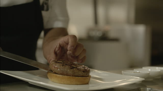 serving beef into a hamburger - putting stock videos & royalty-free footage