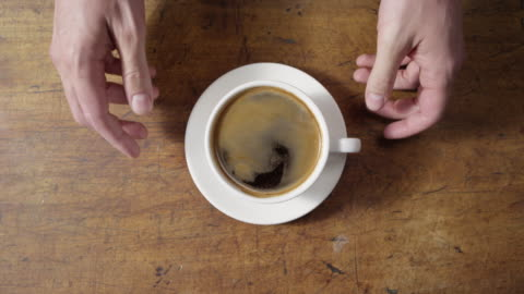 serving coffee on wooden table - kaffee stock-videos und b-roll-filmmaterial