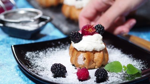 serving cream puffs - brambleberry stock videos & royalty-free footage