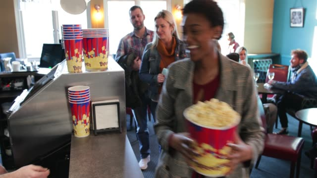 serving customers at the movies - movie theater stock videos & royalty-free footage
