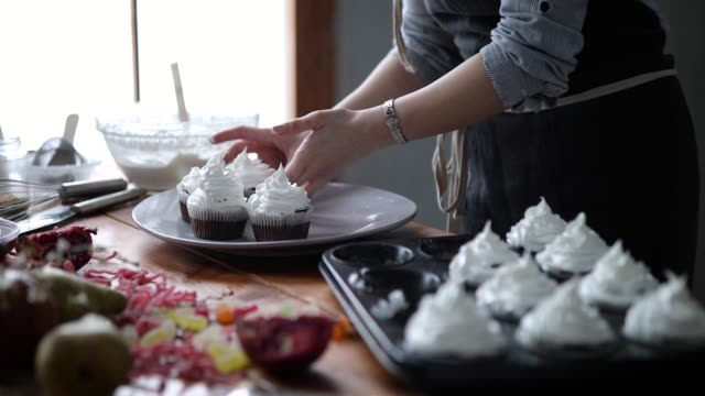 serving delicious cupcakes - cupcake stock videos & royalty-free footage