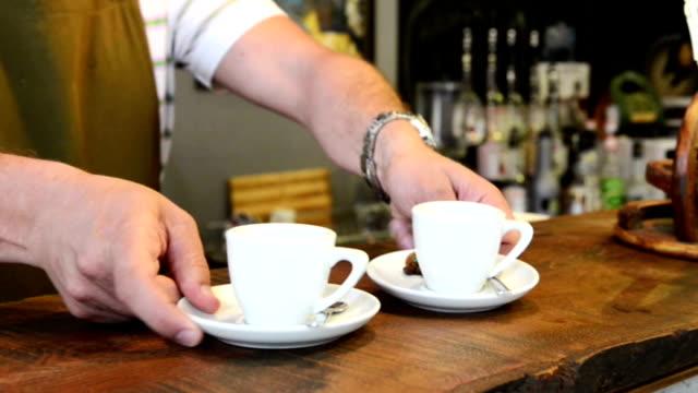 Serving espresso in a coffee shop