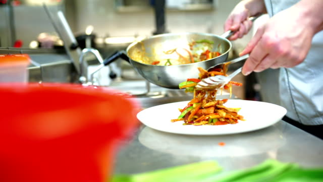 serving food in a restaurant kitchen. - serving tongs stock videos & royalty-free footage