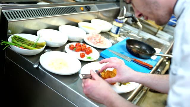 Serving food in a restaurant kitchen.