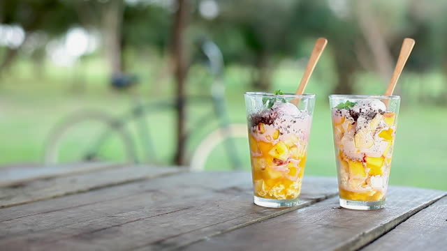 serving fruit salad dessert - picnic table stock videos & royalty-free footage