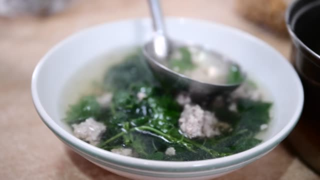 serving gourd soup in bowl, slow motion. - gourd stock videos & royalty-free footage