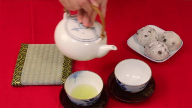 serving green tea and daifuku - tea pot stock videos and b-roll footage