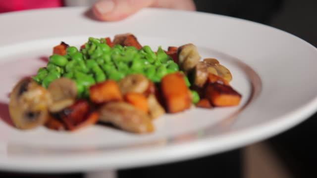 serving of green peas, mushroom and sweet potato - sweet potato stock videos & royalty-free footage